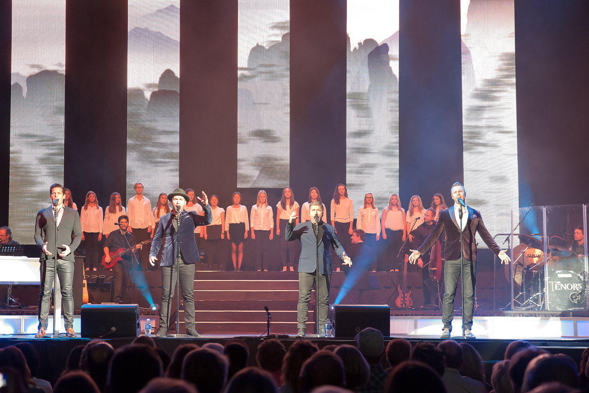 Tenors and Junior Chorale on stage at Abbotsford Entertainment Centre